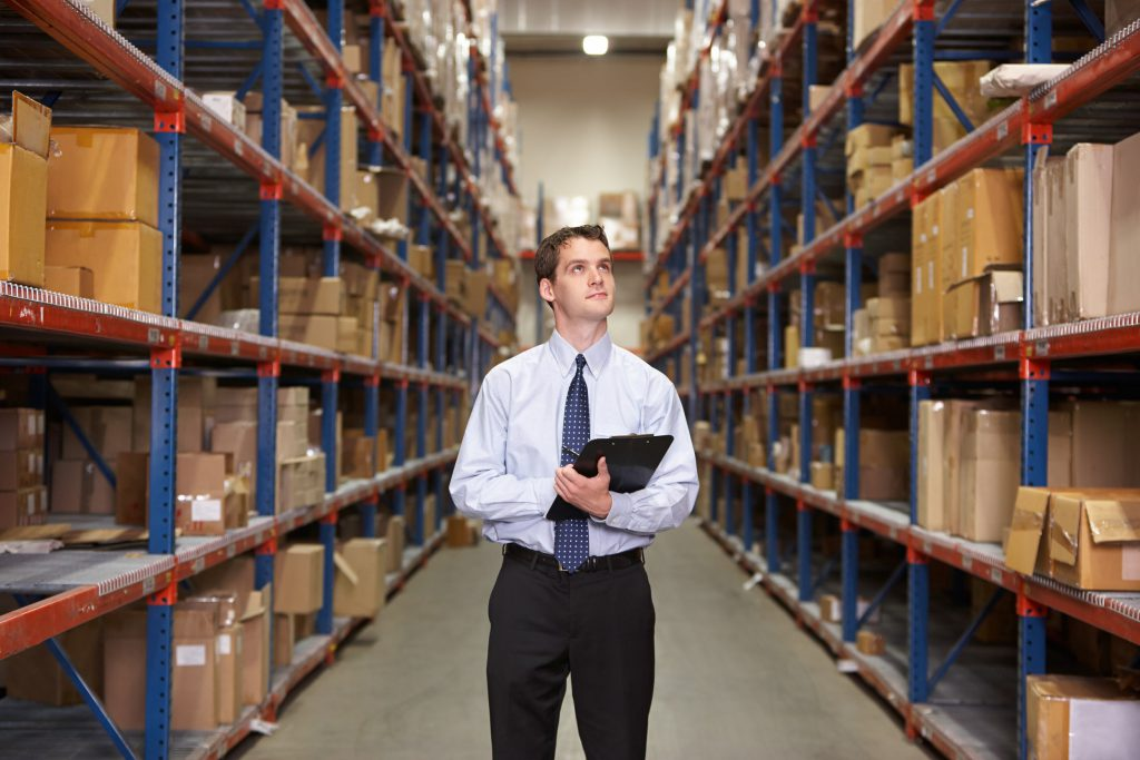 customs broker taking inventory in a warehouse, one of the many warehouse services Cordova Brokerage International