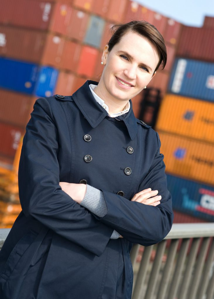 broker standing in front of transportation crates